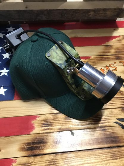 Outlaw Shooter coon hunting light in soft or hard bump cap.  It is a great light.  Outlaw Shooter comes with 3 clicks of bright white main beam, as well as a dim and a bright walk light.